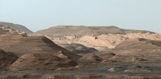 NASA's Mars rover Curiosity has beamed home a gorgeous postcard of the mountainous Red Planet terrain it's currently exploring.