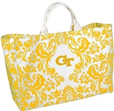 $48 Thick canvas and soft reinforced handles with piping trim give this large tote the perfect look and feel. Great for spring time fun or toting to class. Features the overall damask print and the collegiate logo.