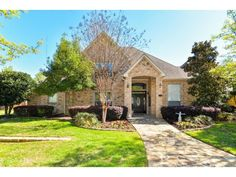You have the rare opportunity to own this incredible estate on over 1 acre in highly desired Mansfield ISD!!! Amazing grand entrance with electric gates & stone-iron fence onto the beautifully landscaped treed yard with LED lighting!!! Enjoy wood floors, granite countertops, stainless appliances, oil rubbed bronze fixtures, iron spindle staircase, camera surveillance system, built in icemaker and more!!!. Downstairs painted March 2017- 2nd downstairs bedroom with full bath & exterior door…