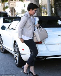 How luxurious: Kris Jenner held on tightly to a stack of magazines that included Luxe, a luxury home design publication, in Beverly Hills on Saturday