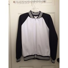 Two tone track jacket Black and white bomber jacket. Slight stain on the front  🚫 No trades or Paypal ✅ Bundles are welcome  📦 Fast shipping 💰 Make me an offer below Jackets & Coats