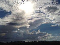 Sun, clouds blue skies