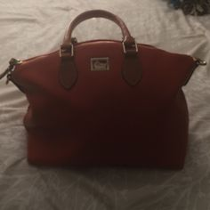 Dooney/Bourke Orange leather used few times Looks brand new only used a few times orange, leather gold zipped great Bags Totes