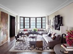 [idea for window area in the living room: a Kagan-like sofa...not rounded like this one, but something that fits nicely into that nook there. A great replica is available through Classic Sofa.--sz] Holly Hunt's Modern Chicago Apartment on Gold Coast | Architectural Digest