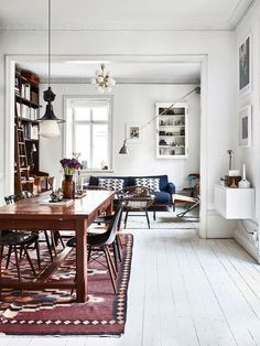 This home, belonging to Swedish photographers Kalle Gustafsson and Sara Bille, is the definition of perfect imperfection. The duo transformed an old, century old building, in Stockholm, into the most idyllic city dwelling - it's a superb mix of vintage charm and modern Scandinavian design.