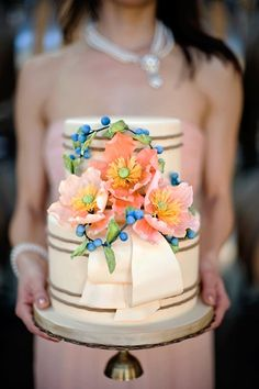 Intricate peach sugar flowers and blue berries. This is such a fresh color combo.