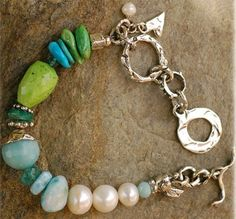 love the combination of turquoise, blue tones and pearls, and the silver findings are especially fabulous!