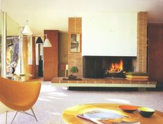 Mid-century modern living room, brick fireplace.