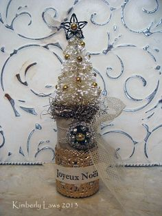 bottle brush tree in vintage bottle