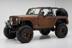69 jeepster commando. Love the old school stuff.