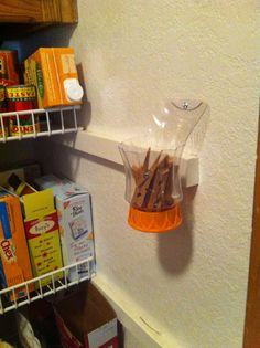 Chip clip holder from OJ bottle because my man could never find them in the drawer. Repurpose or up cycle OJ bottle.