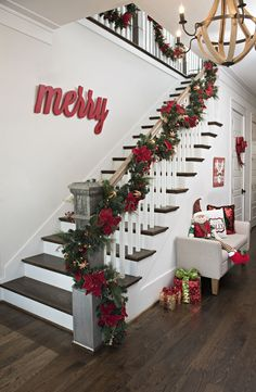 Deck the halls with gorgeous holiday decor from Kirkland's 'Merry and Bright' collection this season! There's no substitute for a sweeping garland with colorful accents in your entryway to welcome guests into your home. Shop the collection to create a win Noel Christmas, Christmas Wreaths, Christmas Crafts, Christmas Entryway, Christmas Staircase Garland, Christmas Ideas, Christmas 2019, Stairway Garland, Kirklands Christmas