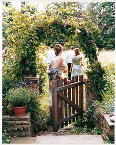 garden gate (with small picket fence) in side yard between stairs & front yard fence (wood)