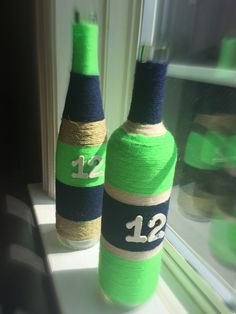 Seattle Seahawks 12th Man inspired wine bottle vases https://www.etsy.com/listing/237313565/seattle-seahawks-12th-man-wine-bottle