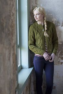 A cropped silhouette livens up a classic cabled cardigan. A woolly, Shetland-style yarn gives definition to Aran styling. Back and fronts are worked separately with raglan shaping.