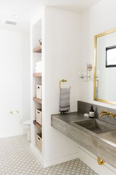 Patterned tiles and floating concrete sink / Studio McGee