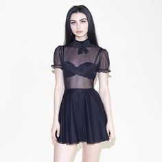 Babydoll... don't mesh with me. Xo! This isn't your average little black dress... Itfeatures a skater skirt, mesh top, bow in the front and a zipper on t...