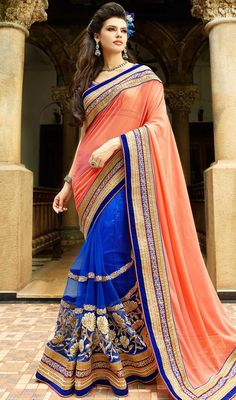 Expose your timeless traditional glimpse dressed in this orange and blue color net georgette half n half sari. The wonderful attire creates a dramatic canvas with fantastic bead, lace, resham and stones work. #onlinewomensarees #indiandesignsaree #beautifulsaricollection