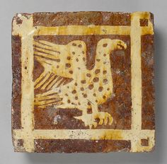 Two-Colored Tile, late 14th century, British, Fired earthenware with slip decoration and lead glaze, 10.5 x 10.5 cm.