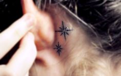 stars      this is the tattoo i got behind my ear before christmas, i edited this photo horribly because imo it is very difficult to get a swell photo of, lmao. but uh yeah, it's inspired by peter pan ya know the part 'second star to the right and straight on till morning' yep it's so typical right but i love ittt. oh and they're dark blue but i don't think it shows well at allll.