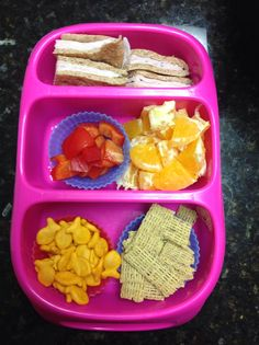 Turkey sandwich , orange pieces, red bell pepper, cinnamon oat square cereal, goldfish