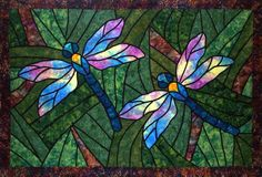 I love stained glass, but I have always wanted to do a mosaic similar to this. Actually, if I could do this in tile on the wall of a tub or shower, I'd love that, either a full wall in great colors, or as a border in more muted tones.