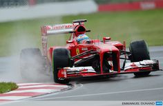 CANADA, Montréal : Ferrari driver Fernando Alonso of Spain races his car during practice in the Canadian Formula One Grand Prix at the Circuit Gilles Villeneuve in Montreal, on June 7, 2013. AFP PHOTO/Emmanuel Dunand