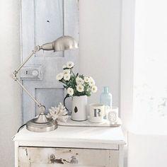 white flowers, blue vintage door, lamp