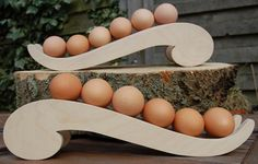 Keep your eggs in order of freshness!     Based on a French Curve this totally unique, handmade, Egg Rack.     The Egg Rack has been designed to be both practical as well as eye catching and will hold 6 large hens eggs.