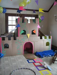 coolest kid castle ever! DIY made of recycled cardboard... Who wants to come over my house when my niece is around 2 or 3 years old?! I'm gonna need help with this bad boy. :)