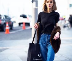 Simple black t-shirt and high-waisted jeans