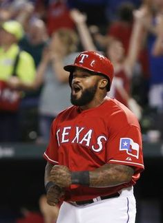 ARLINGTON, TX - MAY 2: Prince Fielder #84 of the Texas Rangers celebrates scoring a run on a three-run home run hit by Shin-Soo Choo during the seventh inning of a baseball game against the Oakland Athletics at Globe Life Park on May 2, 2015 in Arlington,
