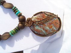 Cabochon Necklace using a bead that was brown and blue.