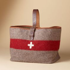 """SWISS ARMY CARRYALL--Vintage Swiss army blankets from the early 1900s form our sturdy and classic carryall, perfect for logs or outdoor gear. Bring home a piece of history. Wool and leather. Switzerland. Approx. 12""""L x 16""""W x 19""""H with strap."""