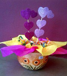 Macetas de barro decoradas con dulces . osoyparis.