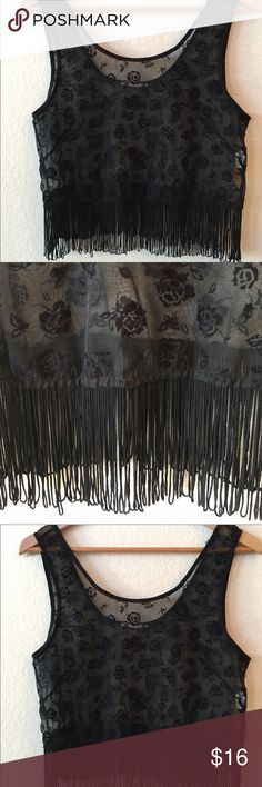 """Lush Sheer fringed top Beautiful rose pattern sheer black tank with Fringe hem. Beautiful layered over tank, camisole or pretty brallette. Measurements laying flat: armpit to armpit 18 1/2"""", length 16"""" + 4"""" Fringe. Excellent condition. Lush Tops"""