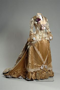 Cream silk brocade and gold and yellow satin gown with lace trim, designed by Emile Pingat, French, 1878. Worn by Mrs. Augustus Newland Eddy.