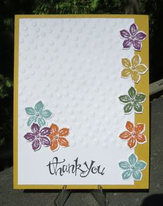 Tiny pearl accents on these petite petal flowers compliment the white dots on the embossed background. Muted colors Hello Honey, Lost Lagoon, Mossy Meadow and Tangelo Twist work well together on this handmade thank you card.