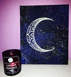 Mandala moon painting with a galaxy background