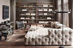 Soho Tufted Upholstered Daybed_ 1950s Dutch Shipyard Shelving_  Rivington Industrial Media Cart_ 1950's Sling Chair_ Camino Floor Lamp_  http://www.restorationhardware.com/