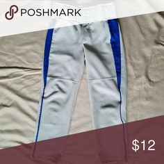 "Grey baseball pants with Royal Blue inset! Augusta Sportswear Boy's Triple Play  baseball pants. Double snap and zipper closure, elastic waist. Beltloops accommodate 2"" belt. Slightly scuffed at knees. Waist runs big, please check measurements.  100% Polyester  Waist 11.5"" Inseam 21"" Augusta Sportswear  Bottoms"