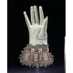 Pair of gloves | Kid leather and satin, embroidered with silk, silver-gilt threads and seed pearls, with silver-gilt bobbin lace and spangles (sequins) -  V&A