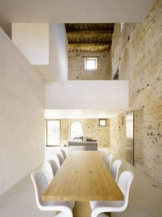 Architecture, Dining Room Rustic Modern Renovated Farmhouse Design With White Interior Color Decorating Ideas Exposed Brick Wall And Large Wooden Table With 8 Panton Chairs: Astonishing Casa Olivi by Wespi de Meuron Architekten Interior Architecture, Interior And Exterior, Interior Ideas, Interior Modern, Stone Interior, Modern Interiors, Classical Architecture, Minimalist Interior, Minimalist Style