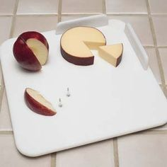 """Adaptive Cutting Boards - Small by North Coast Medical. $46.44. Waterproof Cutting Board, SmallCut and prepare food on the polyethylene Waterproof Cutting Board.Aluminum spikes hold food while cutting. Durable board has rounded edges and is easy to clean. Four rubber suction feet anchor the board securely to the surface. Two polyethylene food guards prevent food from sliding off the board. The Small board measures 7-1/2"""" (19cm) square and weighs 1-1/4 lbs. (.57kg)..."""