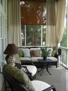 Holy cow, I love this porch. I love the blinds, the curtains, and comfy outdoor living.