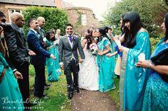 Fun and colorful indian bridal party shot | Image courtesy of Beautiful Life Video & Photography (UK). Discover more Indian Bridal Party inspiration at www.shaadibelles.com #weddings #southasian #shaadibelles #bridesmaids #groomsmens