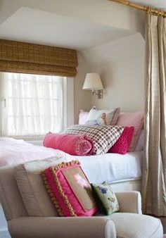 love the bed in the alcove with curtains, also love the pop of pink against the neutrals