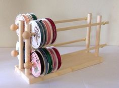 """This adorable four rack ribbon/wire holder is made of solid wood, holds 75  spools (based on 3 1/4"""" wide spools) right at your finger tips. Your spools sit neatly on 4 rows of racks, simply remove by sliding your spools across the wooden dowels, dispense by pulling the ribbon tails. 