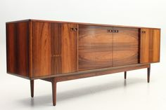 Low sideboard in rosewood. Oak details and drawers. Designed by Ib Kofod Larsen in the 1960s. Produced by Faarup Møbelfabrik, Denmark. www.reModern.dk