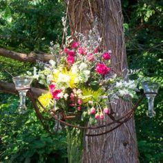 Fresh arrangement hanging from tree. www.markballard.com